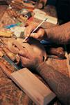 A Maori carver at work...